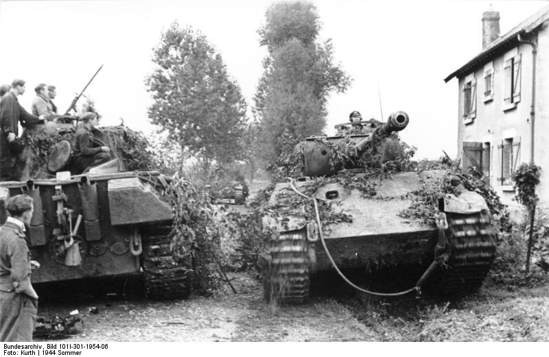 File:Panthers in a French village, Summer 1944.jpg