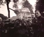 Disabled or abandoned French Char B1 bis tank No. 467, Nivernais II, surrounded by young German soldiers..jpg