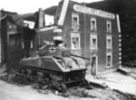 1945, January, Esch-sur-Sure. M4A3 from 5.Fallschirmjäger Division destroyed in front of Hotel des Ardennes.jpg