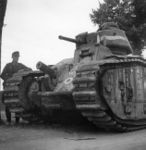 Abandoned Char B1 tank, France, 1940; note German Panzer II in background.jpg