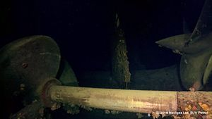 IJN_Hiei_This_is_the_port_outer_propeller_and_shaft._It_has_slid_all_the_way_aft_to_the_cutlass_or_shaft_bearing._It_should_have_been_well_forward_of_the_other_propeller_in_view_to_the_right.jpg