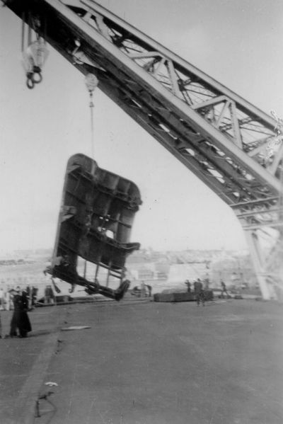Файл:January 1941 HMS Illustrious under repair at Malta. The remains of the aft lift are being removed.jpg