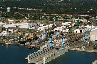 1024px-Newport_News_Shipyard,_aerial_view,_Oct_1994.jpeg