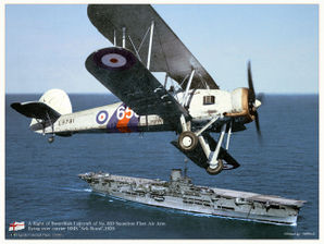 Fairey_Swordfish_на_фоне_авианосца_HMS_Ark_Royal.jpeg