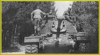 M-48_Tank_on_maneuvers._I_Co.,_1st_Plt..jpg