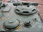 Su122-54 commanders hatch and a vent duct.jpg