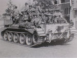U.S 101st Screaming Eagles Paratroopers hitch a ride on a Irish Guards Cromwell tank. Operation Market garden - Holland.jpg