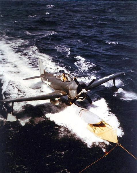 Файл:USS Alaska Recovering a Curtiss SC-1 on 6 Mar 1945 during the Iwo Jima operation.jpg
