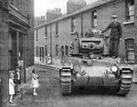 Mk 2 Matilda Tank being driven through Vulcan Village to the testing ground.jpg