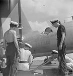 A_repair_squad_at_work_aboard_HMS_UNICORN_at_Trincomalee_in_February_1944..jpeg