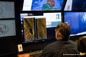 IJN_Hiei_Rob_Kraft_going_through_the_AUV_sonar_data_of_HIEI.jpg