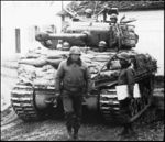 M4A3E8 General PAtton in front of the M4A3E8 tank of the 14th Armoured Division.jpg
