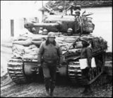 M4A3E8 General PAtton in front of the M4A3E8 tank of the 14th Armoured Division