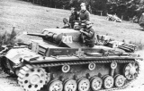 Panzer III with crew driving out in the open