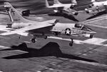 F-8H_Crusader_VF-202_landing_on_JFK_1971.jpg
