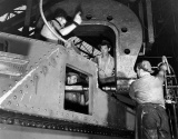 M3 tank under construction. Workers riveting the hull in Chrysler tank arsenal
