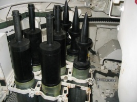 In_front_of_the_loader's_position,_to_the_left_of_the_main_gun,_is_a_nineteen-round_ready_rack._This_tank_is_fitted_out_with_replica_HEAT_and_sabot_ammunition..jpg