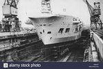 HMS_Unicorn_in_dry_dock,_Singapore_1949.jpg