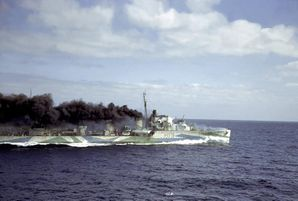 British_destroyer_HMS_Harvester_escorting_a_convoy_en_route_to_Great_Britain_from_the_U.S_seen_from_the_deck_of_a_Cunard_freight_ship,_1941..jpg