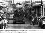 M4A3E8 Castro enters Santa Claka in Sherman tanks.jpg