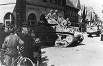 M5 Light Tank with the 7th US Army entering Neustadt a.d. Aisch, Germany on April 6, 1945.png