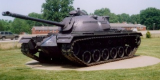 This_M48A2C_features_three_track_return_rollers,_and_lacks_the_small_track_tensioning_idler_previously_found_between_the_last_road_wheel_and_drive_sprocket.jpg