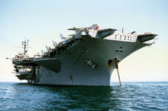 USS_America_(CV-66)_low_view_of_stbd_bow.jpg
