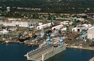 1024px-Newport_News_Shipyard,_aerial_view,_Oct_1994.jpeg