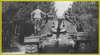 M-48_Tank_on_maneuvers._I_Co.,_1st_Plt..jpg